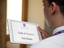 The Code of Conduct being viewed on a tablet